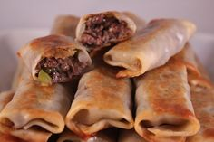 Philly Cheesesteak Egg Rolls....yes, you read that correctly. These will make an appearance at many a NASCAR race-watching Sunday...and I can't wait! :)