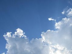 Sky And Clouds 4.  Rays of sunshine can be seen radiating behind great, soft…