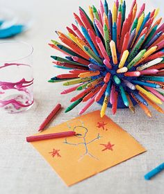 Crayon bouquet centrepiece; let your wedding guests draw to their hearts' content! Unusual wedding table idea.