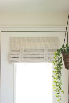 This new Tan Houndstooth French Door curtain is like a Roman Shade without the cords or holes in the door. Fast and easy installation with no hardware needed. Fold it. Flip it. Roll it