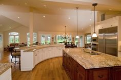 kitchen island ideas  Yes, my next home will be designed around an open kitchen!!!  Just need to find the flat cooktop.