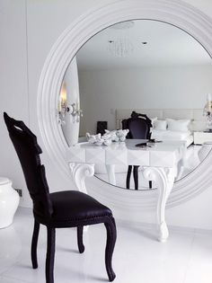 i like how the large mirror is on the wall with the vanity desk pulled up to it... a full length mirror could also work