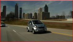 Wheego Whip electric car driving in Atlanta