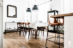 An industrial dining space with pendant light fixtures and polka dot table cloth