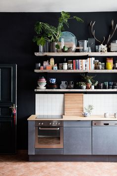 Kitchen with dark wall and open shelves