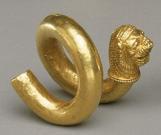 Gold and copper alloy spiral with lion-head terminal  Period: Classical Date: 2nd half of the 5th century B.C. Culture: Greek, Cypriot Medium: Gold, copper alloy