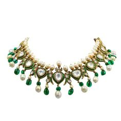 An impressive, vintage, and royal Indian enamel necklace with natural saltwater pearls, old-mine Colombian emerald beads, and large rose cut diamonds. The estimate weight of the diamonds is forty-five to fifty carats. The necklace is presumed to be over 100 years old and is in pristine condition.