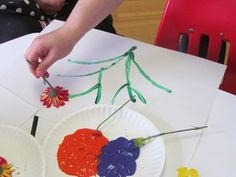 Looking for an activity to follow up on your gardening storytime? Consider painting with flowers... or veggies or anything else you can find in your garden.