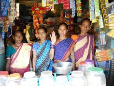These tribal women In Odisha, India are developing their own small businesses with cooperative microfinance. The lady raising her hand will use her portion of the micro loan to purchase lentils, oil, dal, soap, biscuits, potatoes etc. in bulk for her general store. This will help reduce her purchasing & transportation costs as she will replenish her stock less often. The other 3 members own a tyre repairing center, a general shop & a goat business respectively.