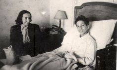 King Feisal in bed with what looks like a sprained or broken ankle, with his maternal aunt, Princess Abdia bint Ali