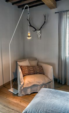 chair by Gervasoni, the linen fabric combined with the ethnic pillow fit well into the Tuscan country style