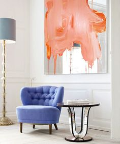 painted mirror with a tufted chair