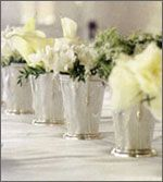 Elegant mini champagne buckets as floral centerpiece vases