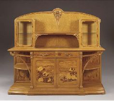 'CHICOREE' CARVED OAK AND MARQUETRY VITRINE  LOUIS MAJORELLE, CIRCA 1905