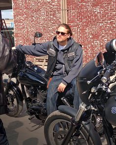 Handsome man, a cut and a bike. What more could a woman want?