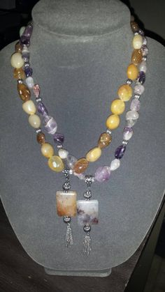 Check out this item in my Etsy shop https://www.etsy.com/listing/207320817/purple-agate-topaz-agate-necklaces-sold