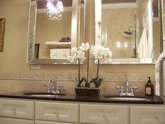 spa master bathroom, this bathroom was basic white tile we replaced it w/cream marble black granite counter new mirrors fixtures and lighting. My favorite part is the new seamless shower door, Bathrooms Design
