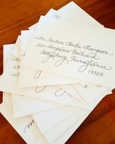 #fancyscript in traditional black ink on itty-bitty envelopes {Calligraphy by Carrie}