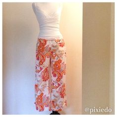 {Hilfiger} Wide Leg Capri Pants: Paisley Print Cotton poplin capris in a fun paisley print of oranges & blues on a white field. Embrace the top colors for 2015 in a cool, comfortable, lightweight pant from Tommy Hilfiger. Pairs with a simple tee, tank or jean jacket for cooler temps. Sandals or sneakers? You decide for casual prep or yacht club chic! Pants feature faux front pockets & side zipper without belt loops.I vowed not to buy anymore clothes that need alteration, but these were to…