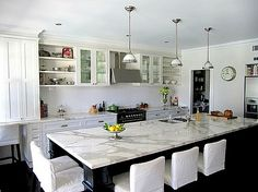 Black cabinetry on the island mixed with gorgeous white marble. This marble does look polished, though.  The owner actually just contacted me and said the marble is honed.  She's a blogger - Porchlight Interiors - see more of her house here:  http://porchlightinteriors.blogspot.com/  #cotedetexas