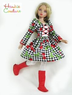Ellowyne steps out in red boots!  Marsha of Hankie Couture created this dress from new, 100% gingham check fabric.  It has red satin ribbons adorned with black buttons. #Hankiecouture  #doll  #Ellowyne