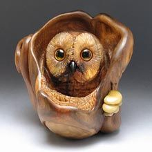 the watchful owl  carved from juniper, eyes are inlaid with amber, beak is of honey horn