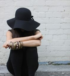 black outfit. hat ~ bangles ~ arm candy ~ jewelry ~ lady ~ white brick ~ bright & beautiful.