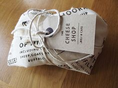 Possible way to wrap up our products/food. We could create a kind of branded fabric wrap, to combine with the stamped swing tags