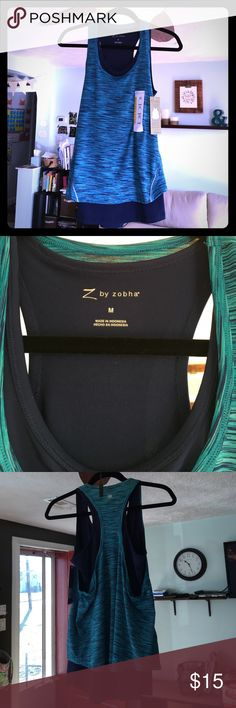 Z by zobha Exercise Tank Top 🎉New With Tags and Never Been Worn!! Two shirts in one, attached. Under shirt is Navy and tighter fitting, over shirt is much looser and is an aqua blue with navy stripes running through it. SIZE MEDIUM. I wear this top in black and I love it! The under shirt tight enough that it's not always lifting up, and the top loose layer hides my imperfections 😘 Z by zofra Tops Tank Tops