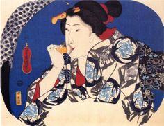 A beauty with a face brush - Utagawa Kuniyoshi