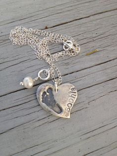Child's actual footprint necklace In Fine SilverHeart by KLMcDesigns, $84.00. I want one! <3