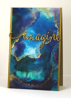 handmade card by Heather Telford ... artistic look backgroud in blues with gold ... water color ... layered die cut IMAGINE in mat gold ... gorgeous!