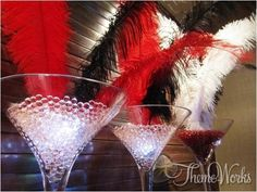 These unique centre pieces which are combining water beads and ostrich feathers look stunning! They would be ideal for a Vegas party.