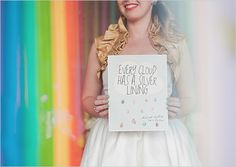 """wedding sign """"every cloud has a silver lining and each raindrop has a rainbow"""""""