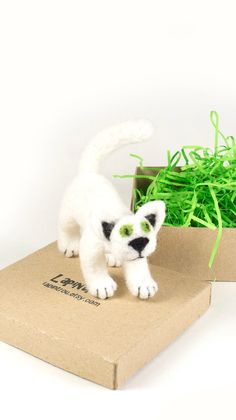 A personal favourite from my Etsy shop https://www.etsy.com/listing/484243947/white-cat-little-pocket-needle-felted