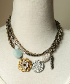 Mixed metal chain with hand wrapped beads, vintage rhinestone, silver pendant and swarovski brass crystal. Length: 19""