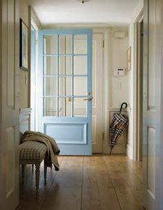 Wide plank floors with glass panes on door...I would paint the door black