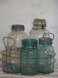 Old Rusty Canning Rack.old mason jars. The canning rack makes a nice container for a center piece. Maybe put candles in the jars. Antique Bottles, Vintage Bottles, Bottles And Jars, Glass Bottles, Vintage Glassware, Vintage Mason Jars, Blue Mason Jars, Canning Rack, Home Canning