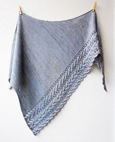 Beautiful cables and lace create an elegant border on this warm & cosy triangular shawl.