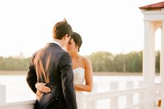 Bride and groom stand on dock at sunset, I'ON Creek Club, Mt Pleasant, South Carolina Kate Timbers Photography. http://katetimbers.com #katetimbersphotography // Charleston Photography // Inspiration