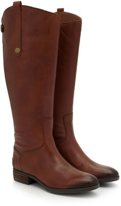 """elegance.Wide Calf Leather Riding BootSpecial Details: Snap Detailing, Zipper Up Back of Leg, Extended Calf CircumferenceClosure: ZipperToe: Rounded ToeMaterial: Basto Crust LeatherInsole: SyntheticHeel height: 1.25 inchesPlatform Height: 0.25 inchesBoot Shaft: 16.75""""Calf Circumference: 17 inches Leather Riding Boots, Calf Leather, Black Leather, Sam Edelman Penny Boots, Equestrian Chic, Shoe Boots, Shoes, Jeans And Boots, Cowboy Boots"""