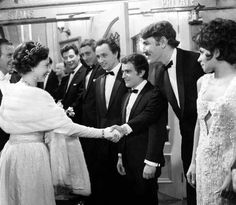 The Queen shakes hands with 'Not Only.But Also' star Peter Cook at the Royal Variety Performance at the London Palladium. Cook's diminutive co-star, Dudley Moore, can be seen to Cook's right - 9 November 1965 Royal Monarchy, British Monarchy, Royal Queen, King Queen, British Actors, British Royals, Princess Margaret, George Vi, Prince Philip