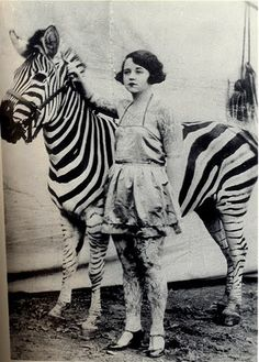 Blowing all the other equestriennes out of the water! A 1920s tattooed lady and her zebra
