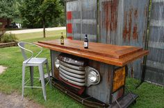 Bar made from reclaimed barn wood a vintage 49 Ford grille, vintage roof tin on cast iron casters. Check us out at Sawtooth Innovations on Face Book. We can create a custom bar for you and your guests to enjoy!