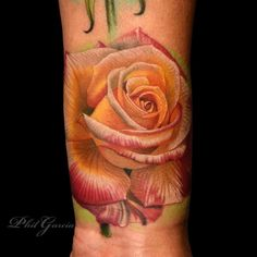 Roses do come in many different colors, and each color has a different meaning as well.Tattoo by Phil Garcia #InkedMagazine #rose #tattoo #tattoos #inked #realism
