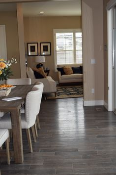 """Armstrong American Scrape hardwood flooring, Nantucket Oak in 5"""" planks. These stunning wood floors are installed in a model for Brookfield Homes in Colorado."""
