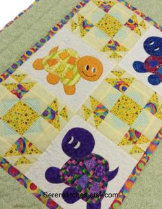 32x 42 quilted baby blanket 100% cotton fabrics Polyester batting Machine pieced Machine appliqués Machine quilted Double folded mitered bindings