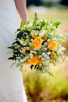 yellow flower in wild wedding bouquet