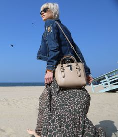 Linda Tol wears a TRUSSARDI JEANS look and the TRU TRUSSARDI Tinny Bag.