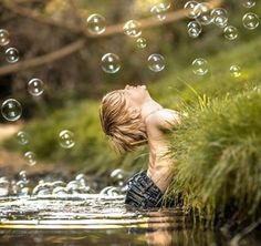 BUBBLES BY THE STREAM.